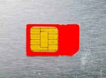 Макрос старой карточки красного цвета SIM Стоковое фото RF