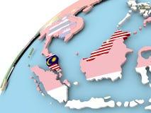 Малайзия на глобусе с флагом бесплатная иллюстрация