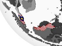Малайзия с флагом на глобусе бесплатная иллюстрация