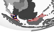 Малайзия с флагом на глобусе иллюстрация вектора