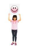 Маленькая девочка держа символ иконы усмешки Стоковая Фотография