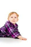 Маленькая девочка играет, взгляд вне Стоковая Фотография