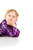 Маленькая девочка играет, взгляд вне Стоковое Фото