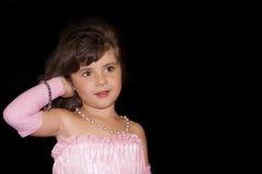 Маленькая девочка на черноте Стоковая Фотография RF