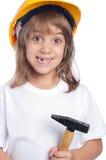 Маленькая девочка нося желтый трудный шлем Стоковые Фотографии RF