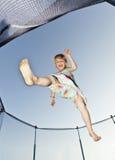 Маленькая девочка скачет Стоковая Фотография