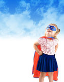 Маленький ребенок спасения супер героя Стоковые Изображения