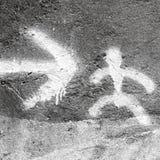 Маленький символ и стрелка человека Стоковое Фото