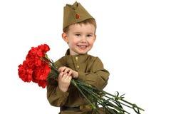Маленький солдат с букетом цветков Стоковое фото RF