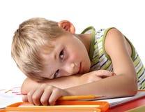 маленький утомлянный школьник Стоковые Изображения