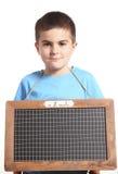 Маленький школьник с chalkboard Стоковые Изображения RF
