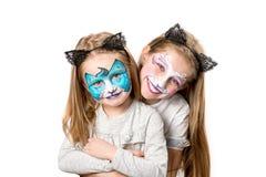 2 маленькой девочки с покрашенными сторонами Стоковое Изображение RF