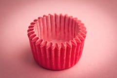 Малый держатель подноса пирожного на розовой предпосылке Стоковое Изображение RF