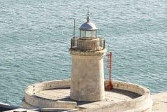 Малый маяк с морем Стоковое Изображение