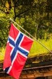 Малый флаг Норвегии в строке внешней Стоковые Фотографии RF
