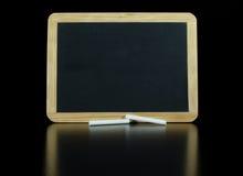 Малый Chalkboard на черной отражательной предпосылке Стоковое Изображение