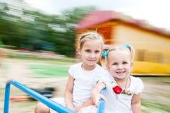 Малыши вращают на carousel Стоковые Изображения RF