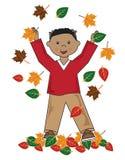 Малыш в мальчике афроамериканца листьев Стоковое фото RF