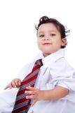 Малыш играя с одеждами и компьютером отца Стоковое Фото