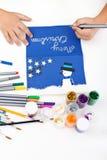 малыш рождества делая открытку Стоковое Изображение