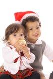 малыш сестры santa шлема стоковые изображения