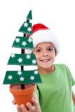 малыш удерживания украшения рождества счастливый стоковые фото
