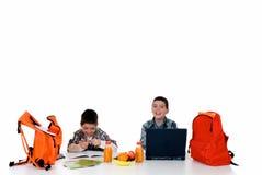 мальчики делая домашнюю работу Стоковое Изображение