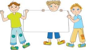 Мальчики проводя пустой плакат Стоковое Изображение RF
