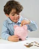 мальчик банка piggy Стоковое Изображение RF