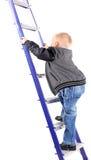 Мальчик взбираясь лестницы, белая предпосылка Стоковые Изображения RF