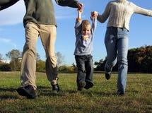 мальчик вручает родителя s Стоковые Изображения RF