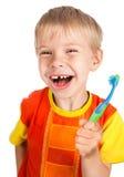 мальчик вручил левую зубную щетку smiley Стоковые Фотографии RF