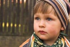 Мальчик в крышке Стоковое Изображение