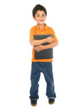 мальчик держа меньшюю школу тетради Стоковые Фотографии RF