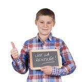 Мальчик держа шифер стоковое изображение