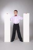 мальчик доски держит белизну Стоковые Изображения