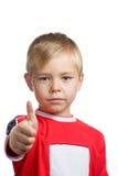 мальчик его большой пец руки вверх по детенышам Стоковое фото RF
