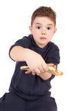 мальчик есть детенышей пиццы Стоковая Фотография