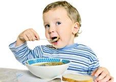 мальчик есть суп стоковое фото rf