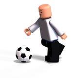 мальчик играет игрушку футбола Стоковое фото RF