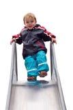 мальчик играя детенышей скольжения Стоковое Изображение