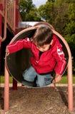 мальчик играя пробку скольжения Стоковое Изображение