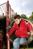 мальчик играя пробку скольжения Стоковые Фото