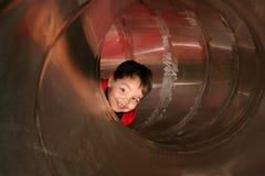 мальчик играя пробку скольжения Стоковое фото RF