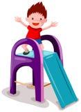 мальчик играя скольжение Стоковые Фото