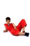 мальчик кладя детенышей Стоковое Изображение RF