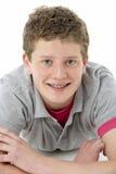 мальчик кладя живот подростковый Стоковые Фотографии RF