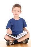 мальчик книги Стоковая Фотография