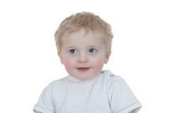 мальчик милый смотрящ вверх белых детенышей Стоковое фото RF