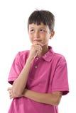 мальчик одевает розовое заботливое стоковая фотография